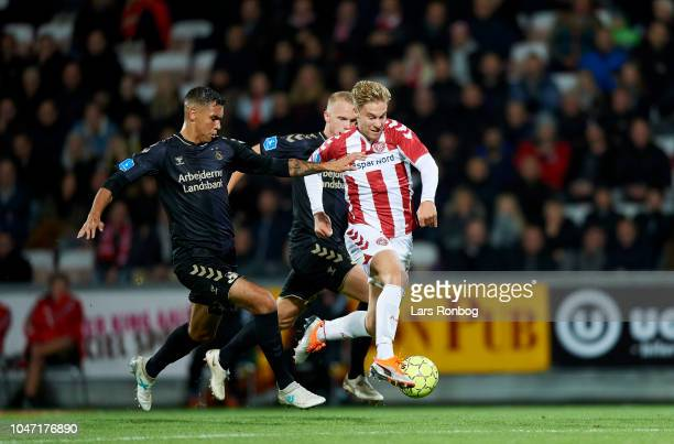 Joel Kabongo of Brondby IF Hjortur Hermannsson of Brondby IF and Tom van Weert of AaB Aalborg compete for the ball during the Danish Superliga match...