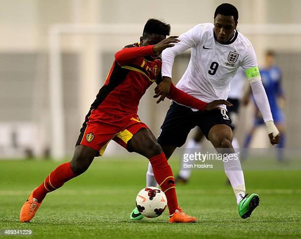 Joel KalonjiKalonji of Belgium holds off pressure from Kaylen Hinds of England during a U16 International match between England and Belgium at St...