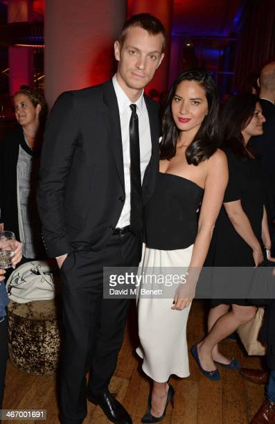 Joel Kinnaman and Olivia Munn attend an after party following the World Premiere of 'RoboCop' at Skylon Restaurant on February 5 2014 in London...