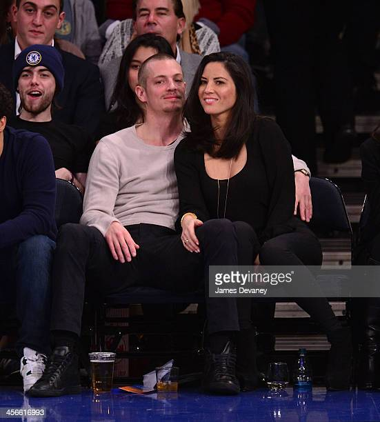 Joel Kinnaman and Olivia Munn attend the Atlanta Hawks vs New York Knicks game at Madison Square Garden on December 14 2013 in New York City