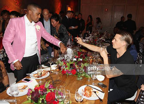 Joel Kinnaman takes a photo of Nas' Hublot Classic Fusion watch at Nas 40th Birthday Celebration Dinner And Party at Avenue NYC on September 12, 2013...