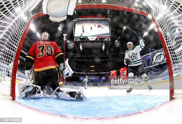 Joel Kiviranta of the Dallas Stars celebrates after teammate Denis Gurianov scores a goal on goaltender Cam Talbot of the Calgary Flames during the...