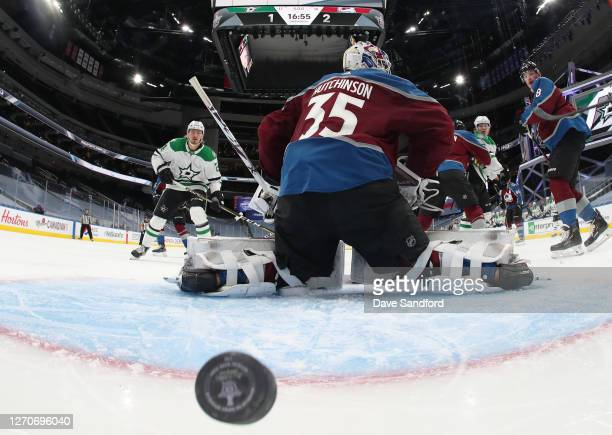 Joel Kiviranta of the Dallas Stars deflects the puck for a goal past goaltender Michael Hutchinson of the Colorado Avalanche in the second period of...