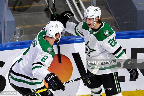 Joel Kiviranta of the Dallas Stars is congratulated by his teammate Jamie Oleksiak after scoring the gamewinning goal against the Colorado Avalanche...