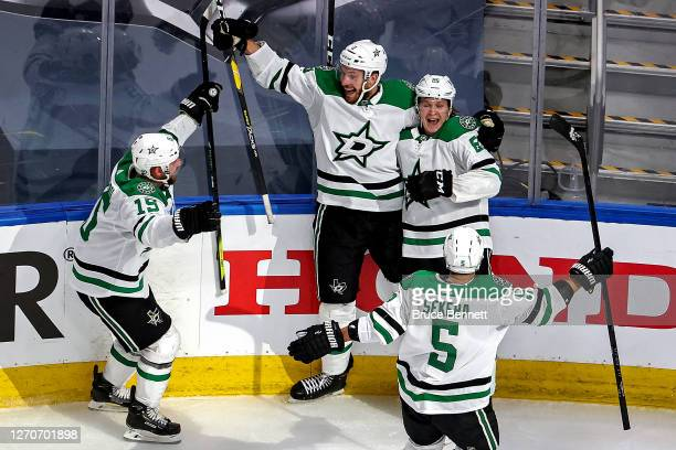 Joel Kiviranta of the Dallas Stars is congratulated by his teammates after scoring the game-winning goal against the Colorado Avalanche during the...