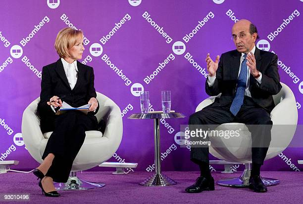 Joel Klein chancellor of the New York City Department of Education right speaks to Judy Woodruff senior correspondent with PBS NewsHour during the...