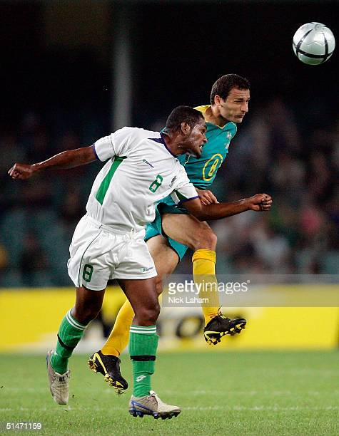 Joel Konofilia of the Solomon Islands challenges Josip Skoko of Australia during the Oceania Nations Cup and the Confederations Cup last qualifying...