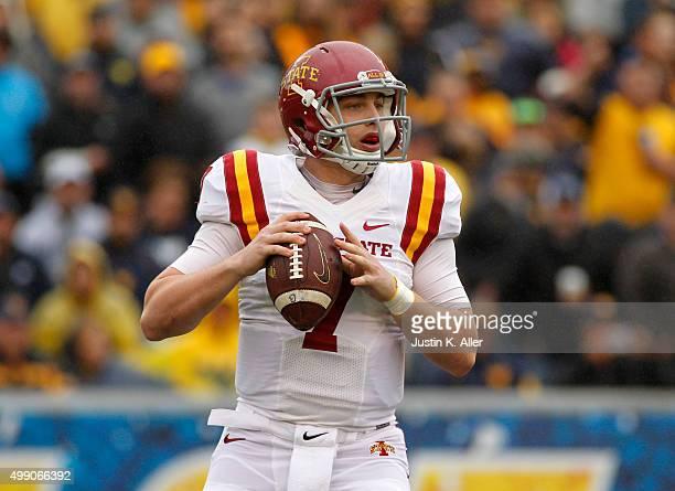 Joel Lanning of the Iowa State Cyclones drops back to pass in the first half during the game against the West Virginia Mountaineers on November 28...