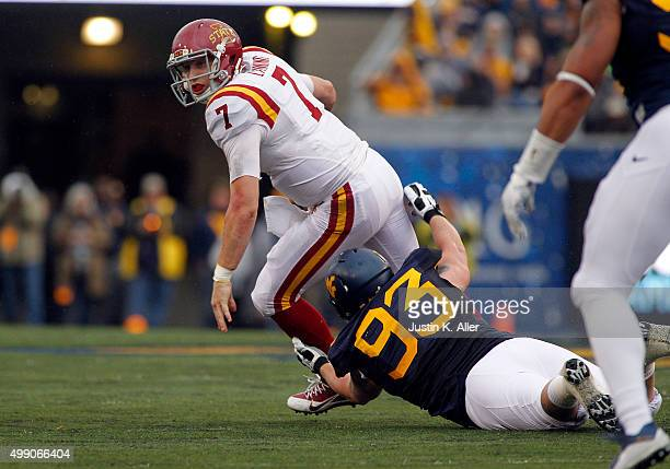 Joel Lanning of the Iowa State Cyclones is sacked in the first half by Kyle Rose of the West Virginia Mountaineers during the game on November 28...