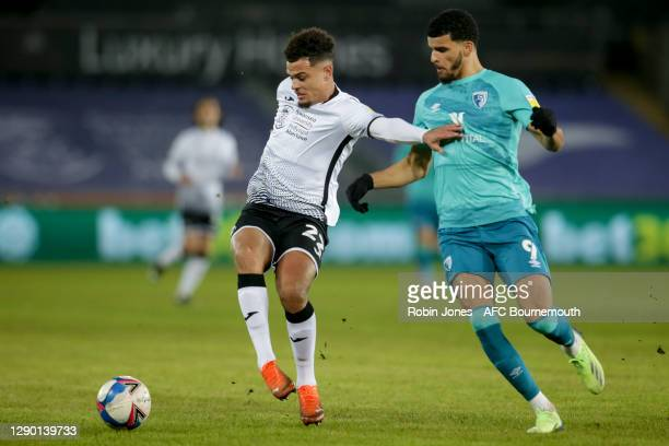 Joel Latibeaudiere of Swansea City holds off Dominic Solanke of Bournemouth during the Sky Bet Championship match between Swansea City and AFC...
