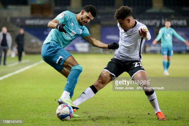 Joel Latibeaudiere of Swansea City holds up Dominic Solanke of Bournemouth during the Sky Bet Championship match between Swansea City and AFC...