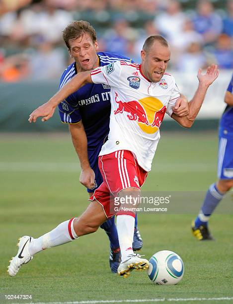 Joel Lindpere of the New York Red Bulls advances the ball past Jimmy Conrad of the Kansas City Wizards on June 26 2010 at Community America Park in...