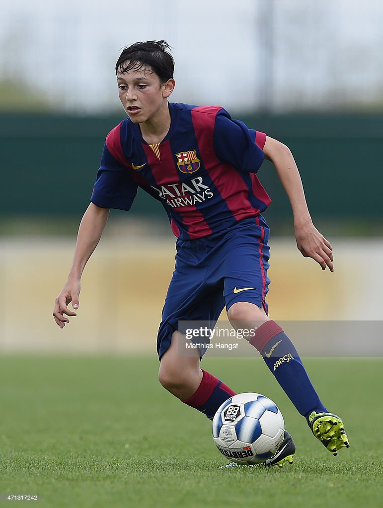 Joel Lopez Salguero of Barcelona controls the ball during the Final of the Santander Cup for U13 teams between FC Barcelona and VfB Stuttgart at Borussia Park Fohlenplatz on April 26, 2015 in Moenchengladbach, Germany.