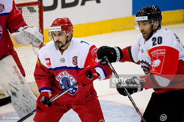 Joel Lundqvist of Frolunda Gotenburg attacks Klemen Pretnar of Yunost Minsk during the 3rd period of Champions Hockey League Round of 32 match...