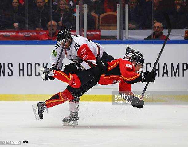 Joel Lundqvist of Frolunda Gothenburg challenges Marcus Fagerudd of Lulea Hockey during the Champions Hockey League Final match between Lulea Hockey...