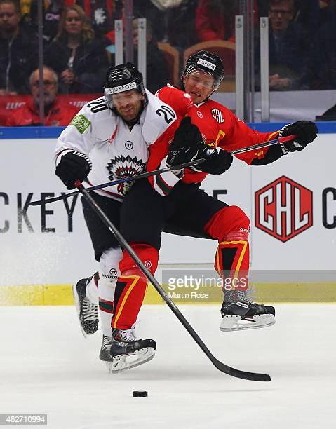 Joel Lundqvist of Frolunda Gothenburg challenges Marcus Fagerudd of Lulea Hockey during the Champions Hockey League Final match between Lulea Hockey...