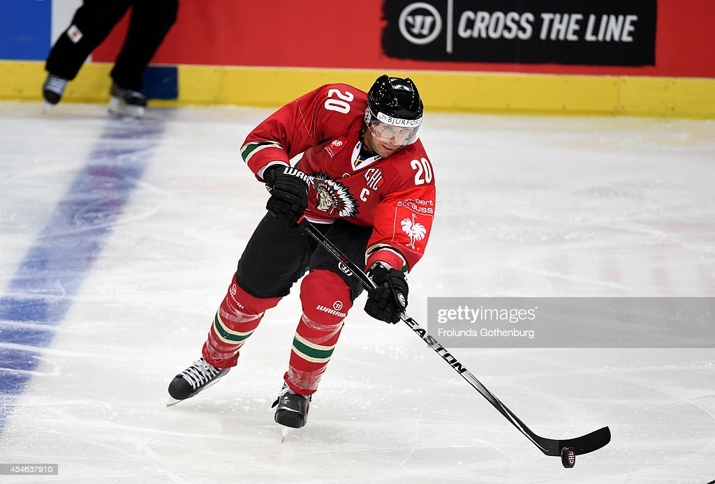 Joel Lundqvist #20 of Frolunda moves the puck during the Champions Hockey League group stage game against Geneve-Servette on September 4, 2014 in Gothenburg, Sweden.