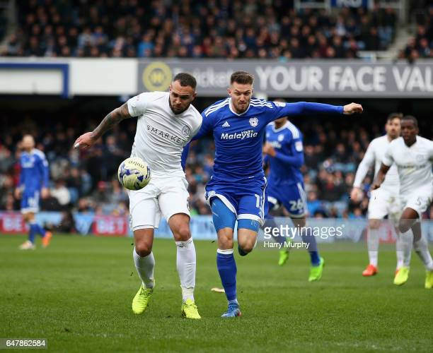 Joel Lynch of Queens Park Rangers and Anthony Pilkington of Cardiff City challenege for the ball during the Sky Bet Championship match between Queens...