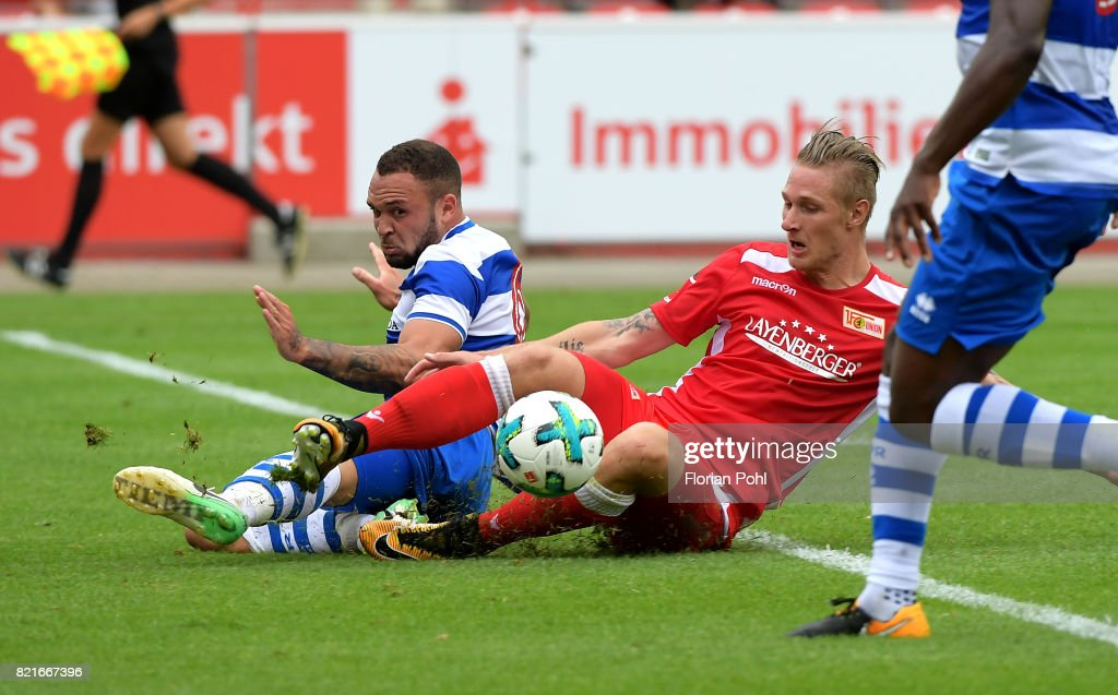 Joel Lynch of the Queenspark Rangers and Sebastian Polter of 1.FC Union Berlin during the game between Union Berlin and the Queens Park Rangers on july 24, 2017 in Berlin, Germany.