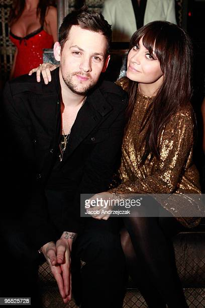 Joel Madden and Nicole Richie pose at Lavo at the Palazzo on December 31 2009 in Las Vegas Nevada