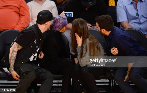 Joel Madden, Nicole Richie, Stellina B and David Katzenberg and attend a basketball game between the Portland Trail Blazers and the Los Angeles...