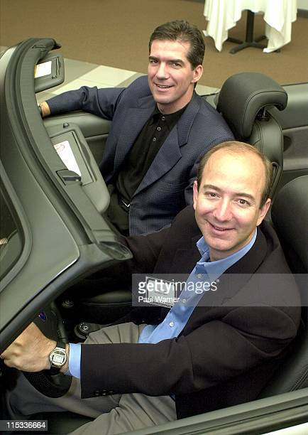 Joel Manby CEO of Greenlightcom and Jeff Bezos CEO of Amazoncom during a press conference announcing Amazoncom and Greenlightcom uniting to launch a...