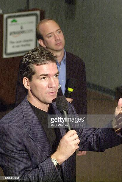 Joel Manby CEO of Greenlightcom and Jeff Bezos CEO of Amazoncom talk to reporters during a press conference announcing Amazoncom and Greenlightcom...