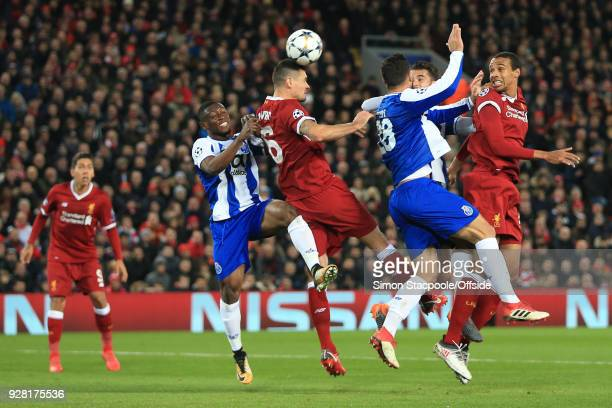 Joel Matip and Dejan Lovren of Liverpool compete for the ball during the UEFA Champions League Round of 16 Second Leg match between Liverpool and FC...