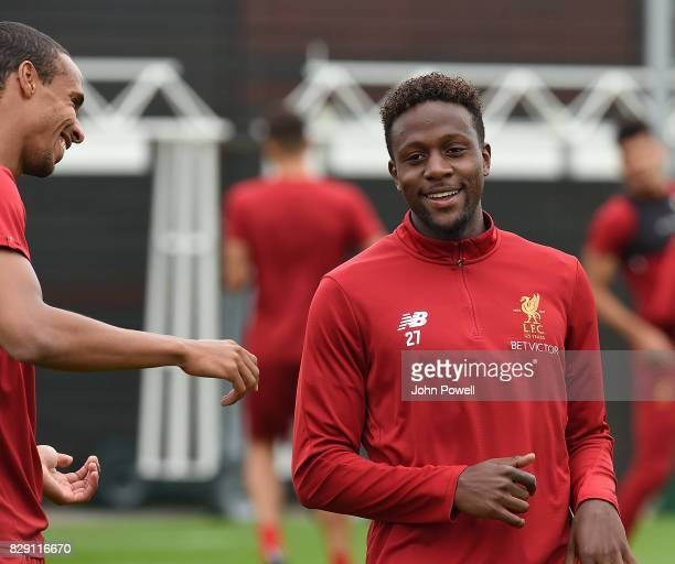 Joel Matip and Divock Origi of Liverpool during a training session at Melwood Training Ground on August 10 2017 in Liverpool England