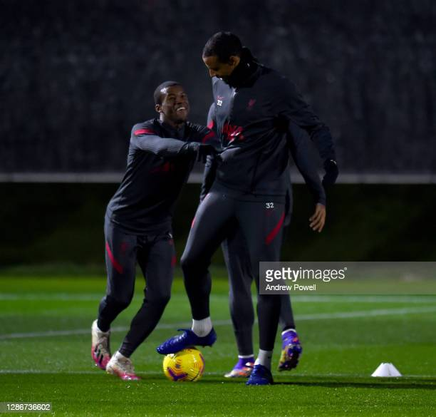 Joel Matip and Georginio Wijnaldum of Liverpool during a training session at AXA Training Centre on November 20, 2020 in Kirkby, England.