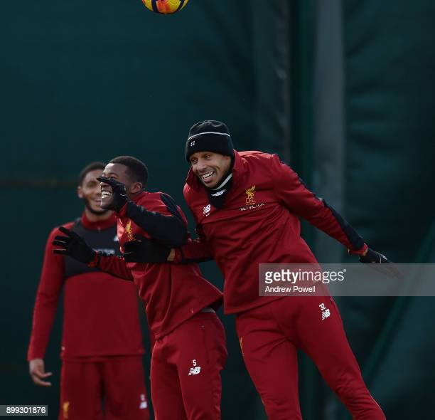 Joel Matip and Georginio Wijnaldum of Liverpool during a training session at Melwood Training Ground on December 28 2017 in Liverpool England