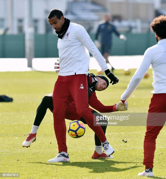 Joel Matip and Loris Karius of Liverpool during a training session at Melwood Training Ground on February 27 2018 in Liverpool England