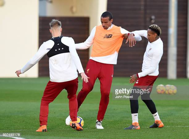 Joel Matip and Nathaniel Clyne of Liverpool during the training session at Melwood Training Ground on March 15 2018 in Liverpool England