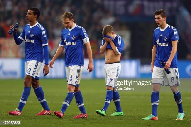 Joel Matip Benedikt Hoewedes Max Meyer and Leon Goretzka of Schalke react after the UEFA Champions League Round of 16 first leg match between FC...