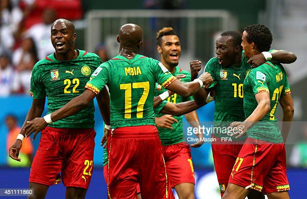 Joel Matip of Cameroon celebrates scoring his team's first goal with his teammates during the 2014 FIFA World Cup Brazil Group A match between...