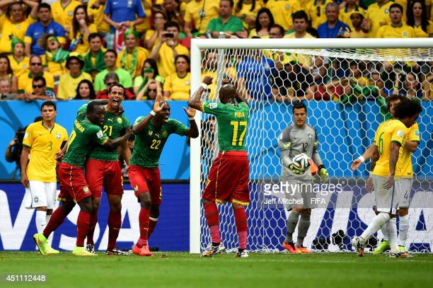 Joel Matip of Cameroon celebrates scoring his team's third goal with his teammates Vincent Aboubakar Allan Nyom and Stephane Mbia during the 2014...