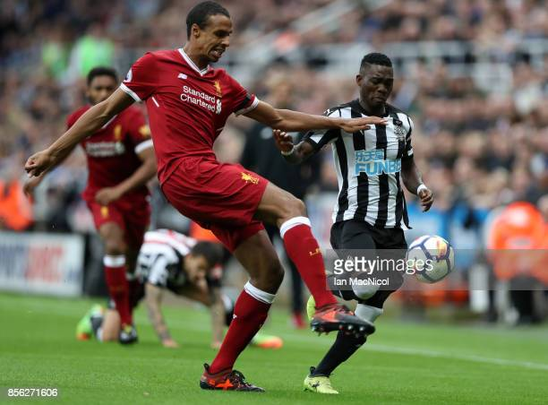 Joel Matip of Liverpool and Christian Atsu of Newcastle United battle for possession during the Premier League match between Newcastle United and...