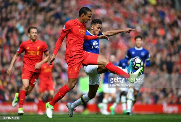 Joel Matip of Liverpool and Dominic CalvertLewin of Everton battle for possession during the Premier League match between Liverpool and Everton at...