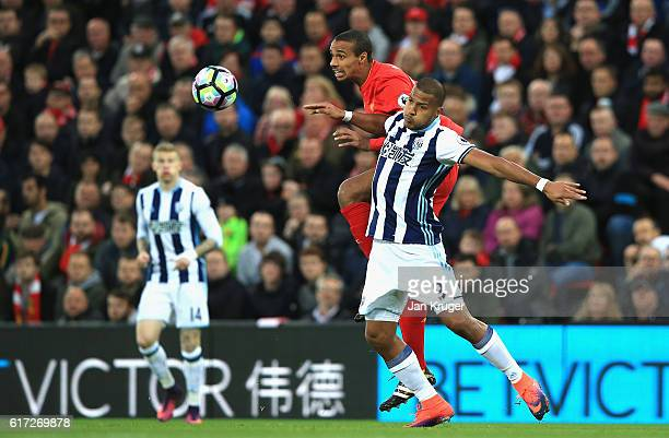 Joel Matip of Liverpool and Jose Salomon Rondón of West Bromwich Albion battle for the ball in the air during the Premier League match between...