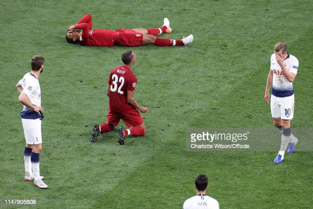 Joel Matip of Liverpool and Virgil van Dijk collapse in elation whilst Harry Kane of Tottenham hides his face in his hands at the final whistle at...