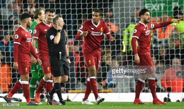 Joel Matip of Liverpool argues with referee Jonathan Moss during the Premier League match between Liverpool and Tottenham Hotspur at Anfield on...
