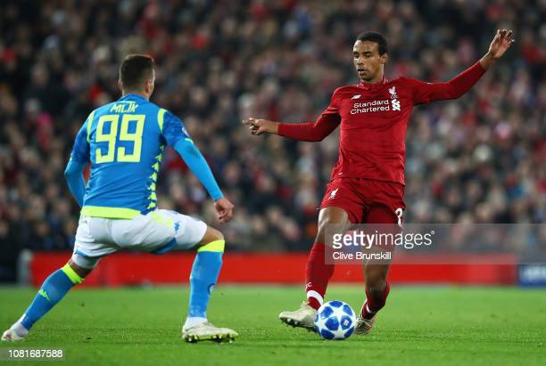 Joel Matip of Liverpool attempts to move away from Milik Arkadiusz of Napoli during the UEFA Champions League Group C match between Liverpool and SSC...