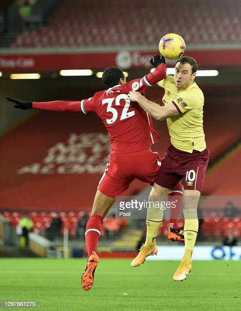 Joel Matip of Liverpool battles for possession with Ashley Barnes of Burnley during the Premier League match between Liverpool and Burnley at Anfield...