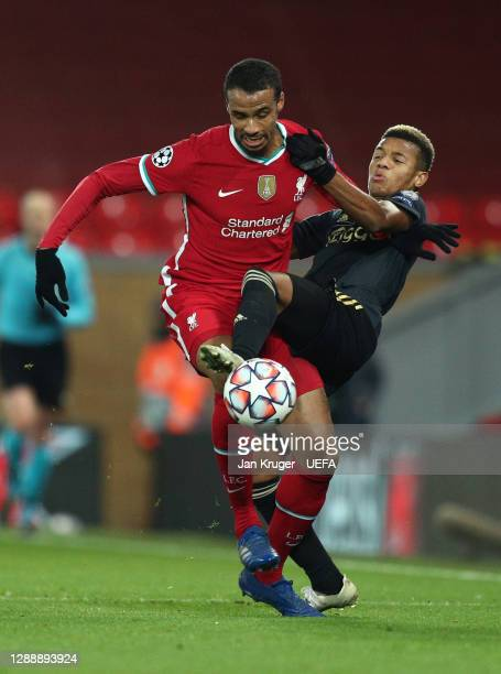 Joel Matip of Liverpool battles for possession with David Neres of Ajax during the UEFA Champions League Group D stage match between Liverpool FC and...