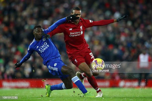 Joel Matip of Liverpool battles for possession with Onyinye Wilfred Ndidi of Leicester City during the Premier League match between Liverpool FC and...
