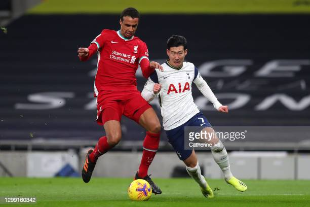 Joel Matip of Liverpool battles for possession with Son Heung-Min of Tottenham Hotspur during the Premier League match between Tottenham Hotspur and...