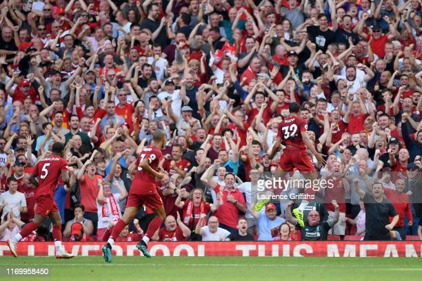 Joel Matip of Liverpool celebrates after scoring his team's first goal during the Premier League match between Liverpool FC and Arsenal FC at Anfield...