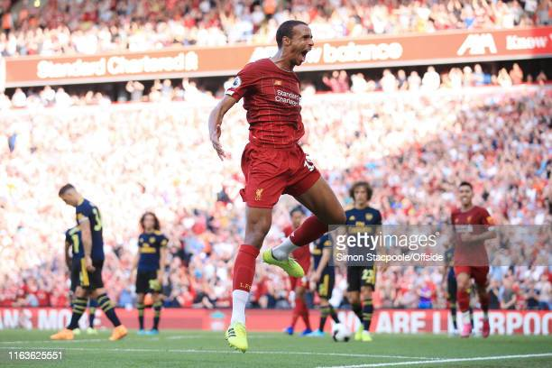 Joel Matip of Liverpool celebrates after scoring their 1st goal during the Premier League match between Liverpool and Arsenal at Anfield on August 24...