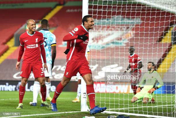 Joel Matip of Liverpool celebrates after scoring their sides third goal during the Premier League match between Liverpool and Wolverhampton Wanderers...