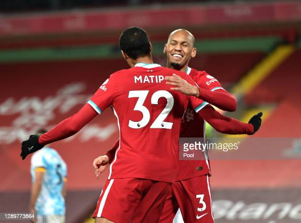 Joel Matip of Liverpool celebrates with team mate Fabinho after scoring their sides third goal during the Premier League match between Liverpool and...